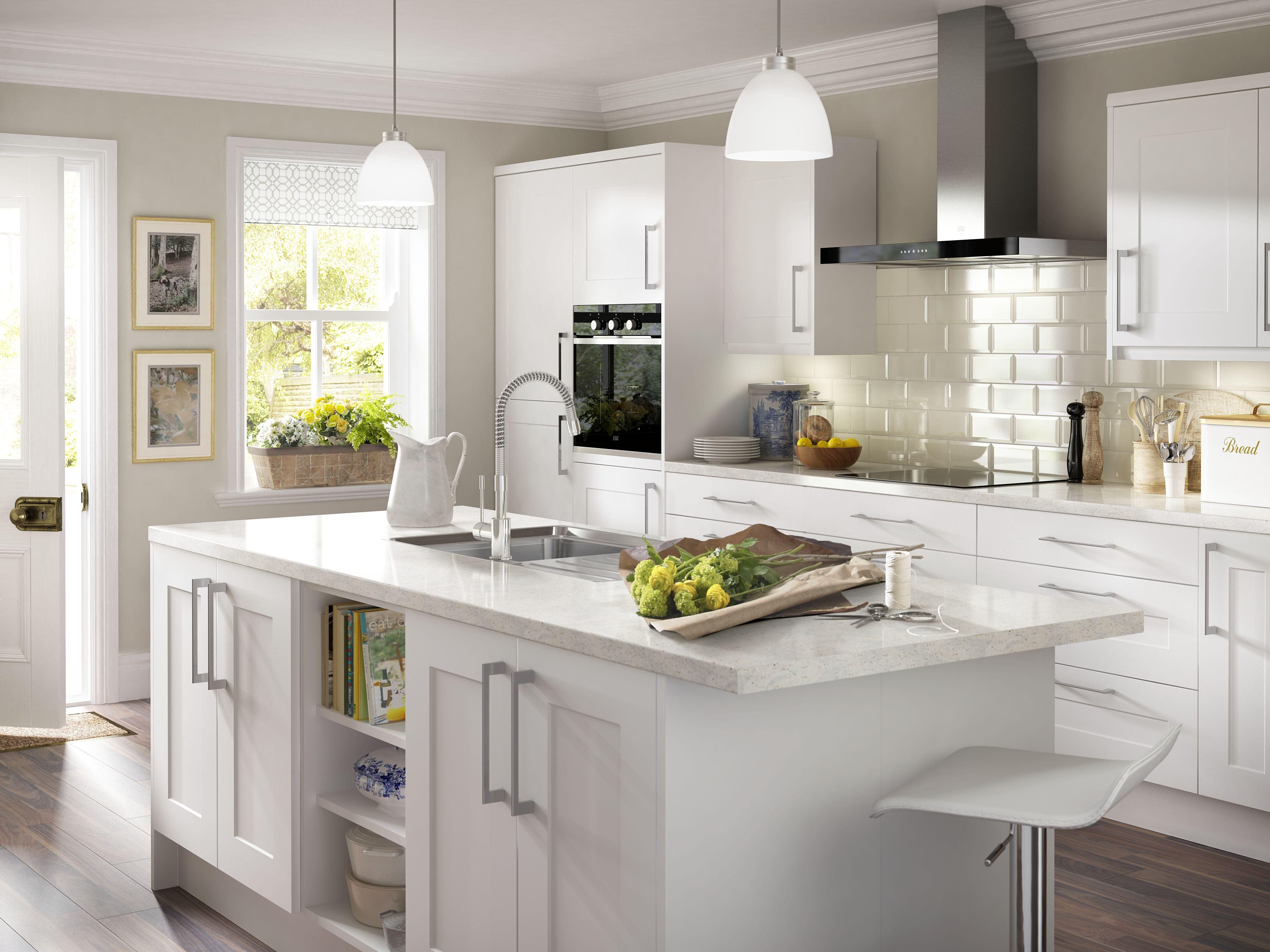 An all white kitchen gives you the scope to introduce subtle pockets ...