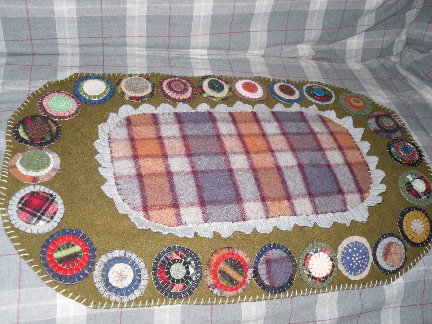 Folk art penny rug made from reclaimed wool sweaters and blankets
