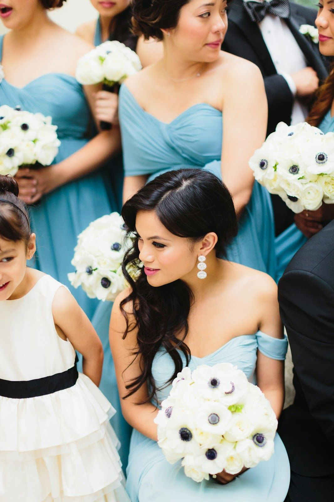 Black and white anemones bouquet with blue bridesmaid dress