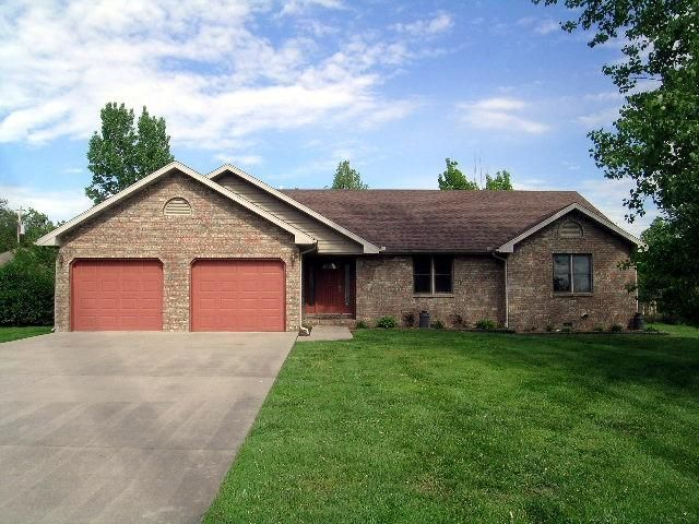 Great all brick 1,793 sq ft home. This 3 bedroom, 2.5 bath home has an oversized attached garage. One of the stalls is almost 32 ft. deep. Perfect for a boat or work space. There is a newer deck, which overlooks the large 1/2 acre lot in Mansfield MO