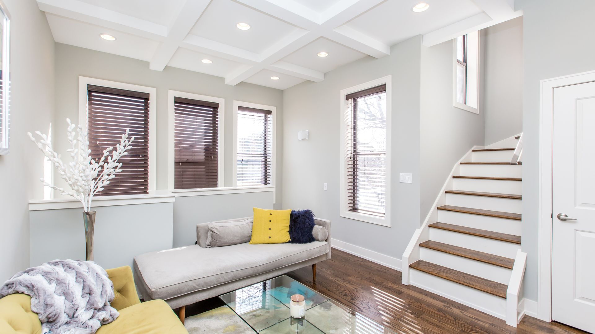Modern living room with vaulted ceilings, crown molding, hardwood ...