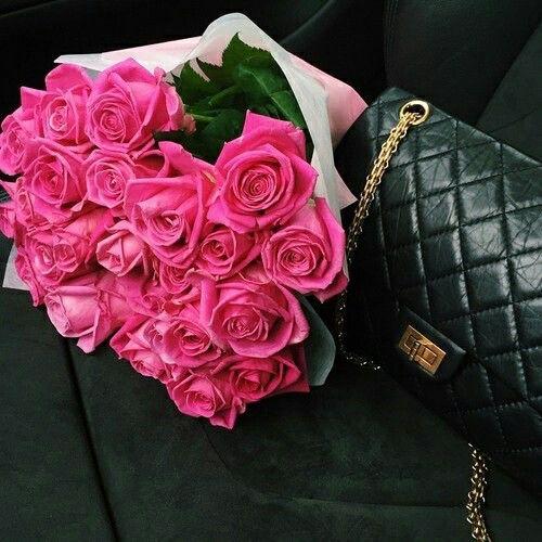beautiful pink roses and a cute handbaq. 😄