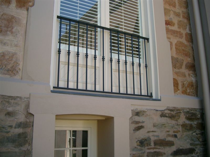 Window railing this simple design could work for for Iron window design house