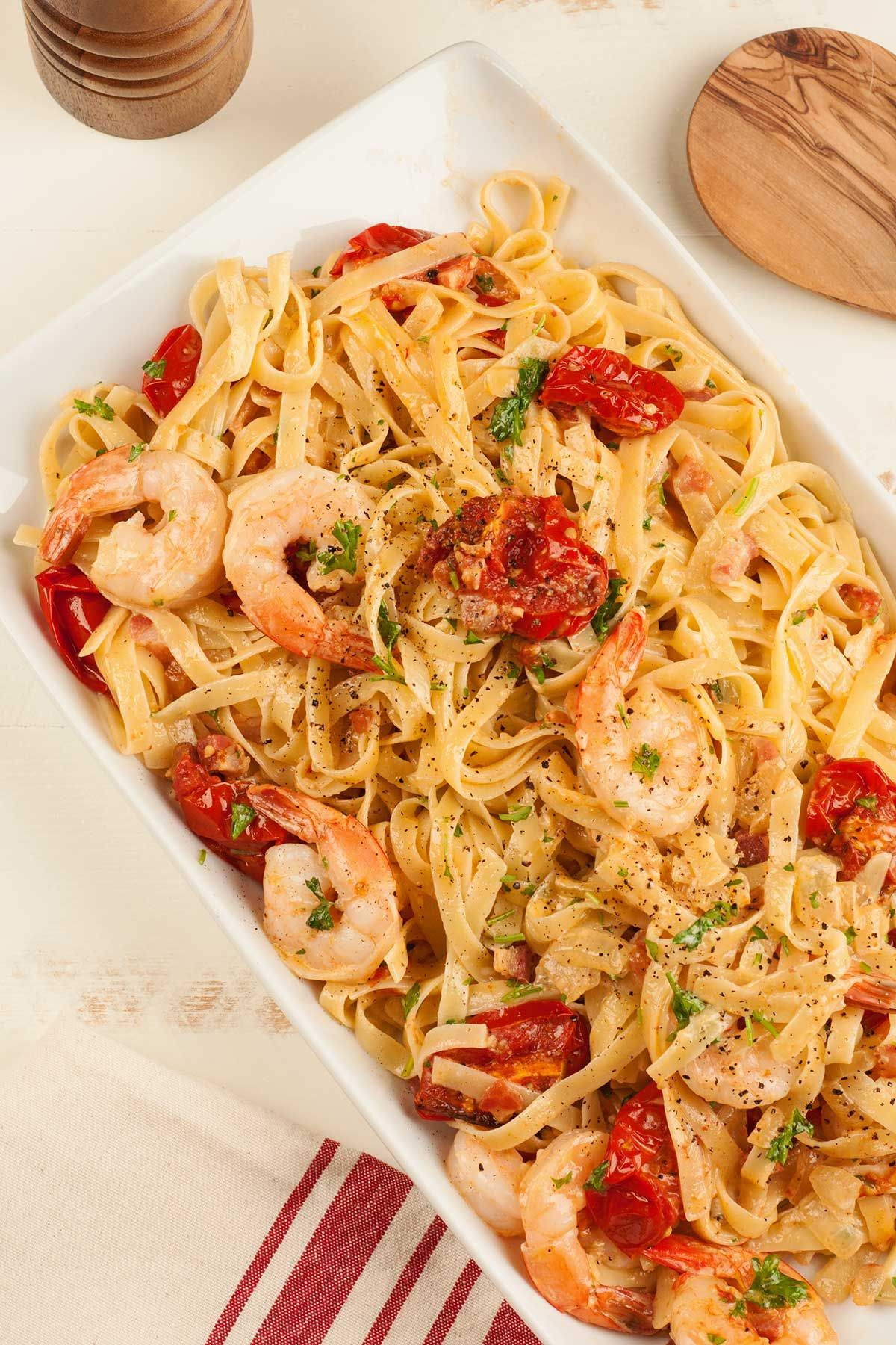Fettuccine with Pancetta, Roasted Tomatoes and Shrimp: This simple, flavorful pasta dish made with sautéed shrimp, diced pancetta and roasted tomatoes can be served as a weeknight dinner or casual company meal.