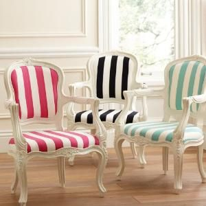 I have my granddaddy's chair and ottoman that looks just like these, but dark wood and needs recovering.  Love the stripes!!