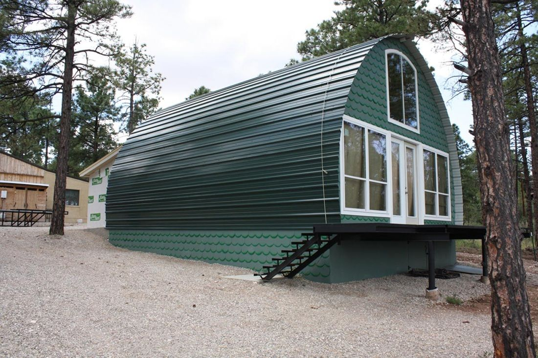 Prefab Metal Cabins For 10k And Less Make A Great Off Grid Option Arched Cabin Quonset Hut Homes Building A Cabin