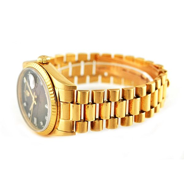 Rolex 18 Karat Men's President Rolex President in 18 karat yellow gold with original chocolate diamond dial.   This exquisite timepiece comes with box and papers.