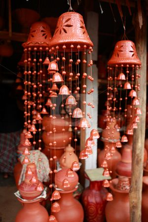 Handicraft pottery wind chimes stock photo, Elegant pottery wind chimes in the shape of bells on sale at a roadside stall in Sri Lanka. by Paul Cowan❤❤❤