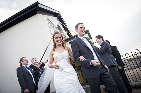 bride and groom exiting church.