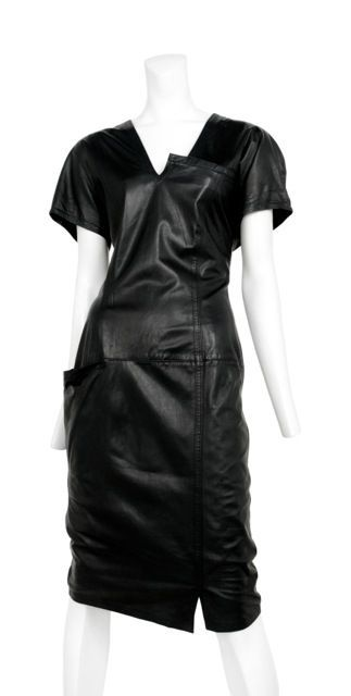 www.resurrectionvintage.com Versace LEATHER DRESS Soft leather dress with interesting neckline detail and hip pouch pocket. Relaxed easy fit through shoulders and waist. A stunning example of early Gianni Versaces work.