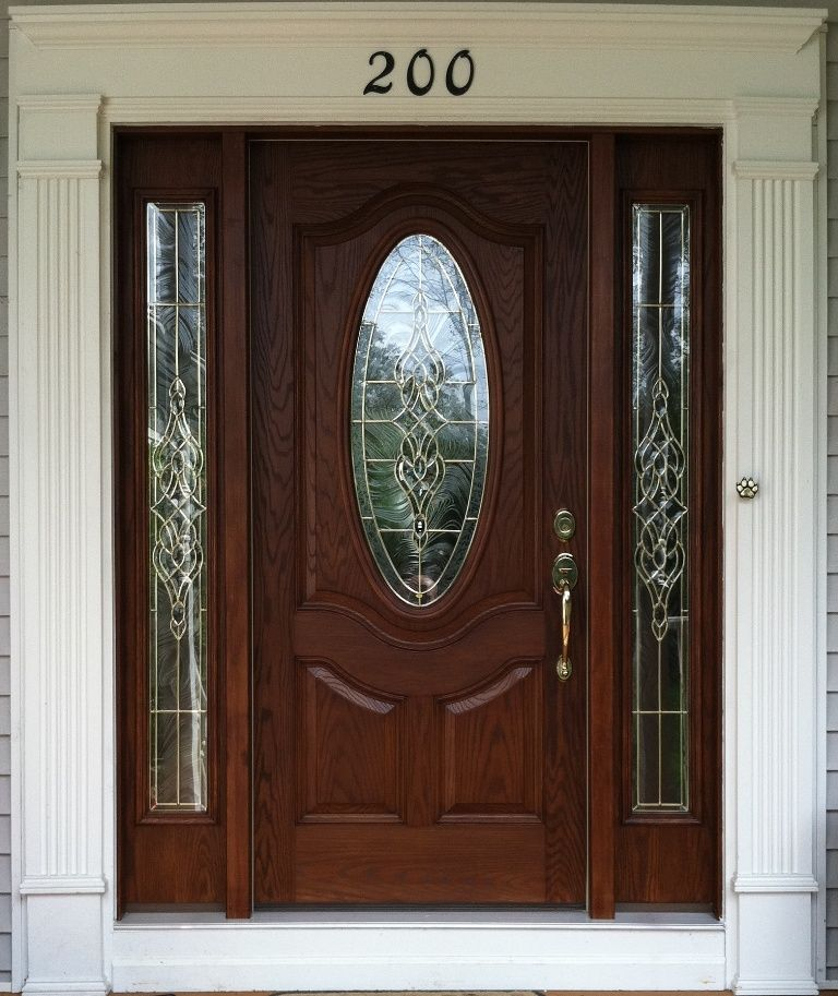 Small oval stained fiberglass door with sidelights for Small exterior doors