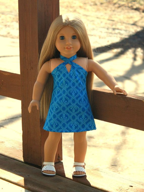 """This dress is perfect for spring and so cute and stylish with the nautical, anchor and rope print.  Included in this listing: • This listing is for one A-line halter dress. The dress closes in back with thin, low-profile Velcro. The halter portion ties at the back of the neck. The dress is fully lined.  The doll and any other props not listed are not included in this listing. All seams are professionally finished.  This outfit is great for any American Girl doll or other 18""""dolls such as…"""