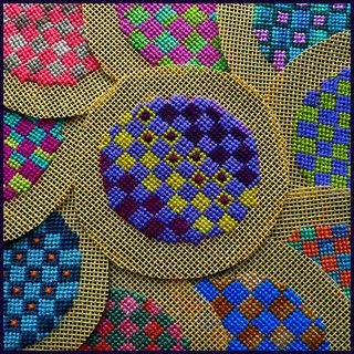 Embroidery pieces ready for buttons. Petit Point Embroidery by Birthine, via Flickr.