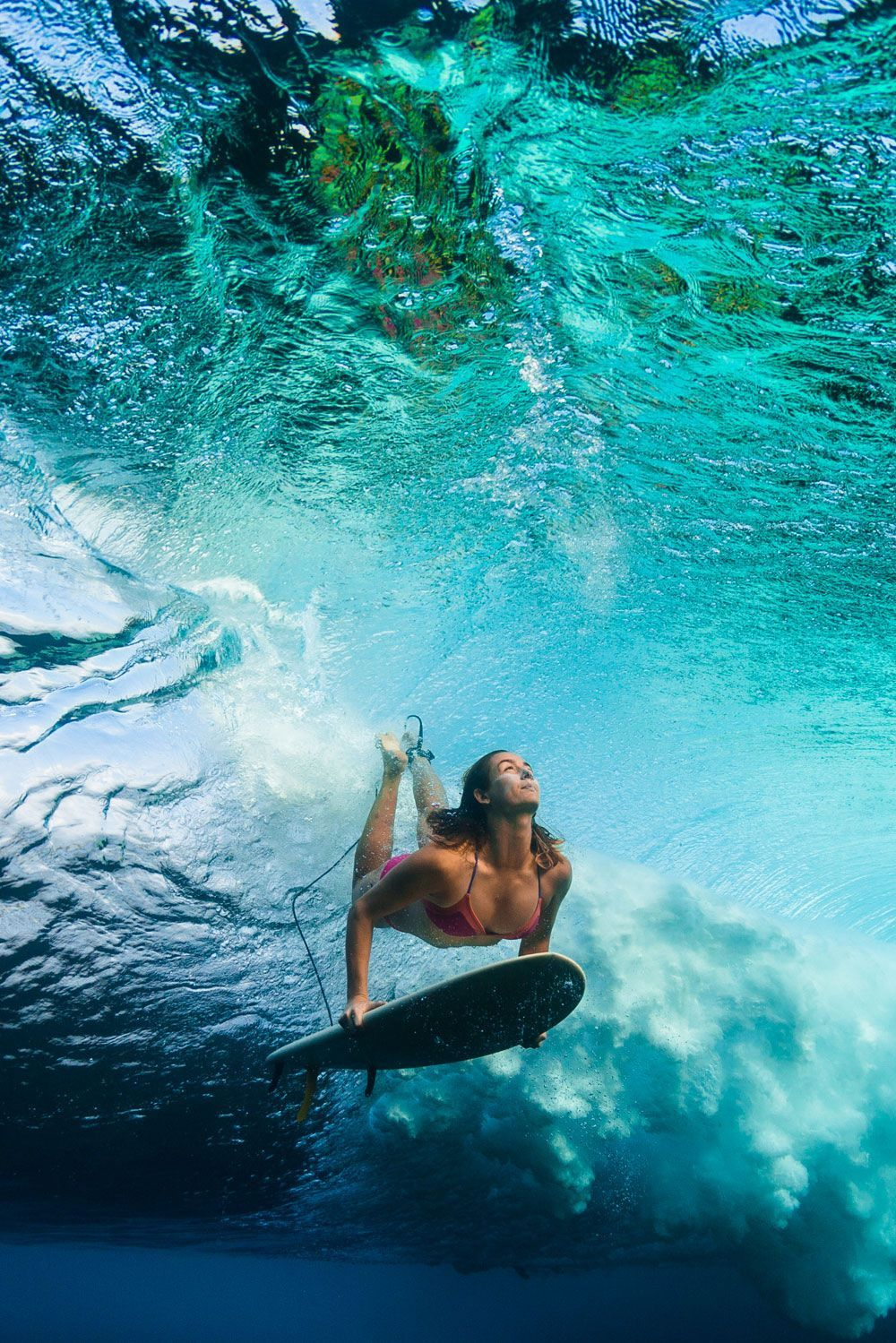 prAna Ambassador, Anna Ehrgott duck diving in Hawaii