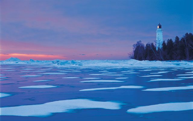 At sunrise the Cana Island lighthouse shines over a wintry bay in Door Peninsula of & At sunrise the Cana Island lighthouse shines over a wintry bay in ... pezcame.com