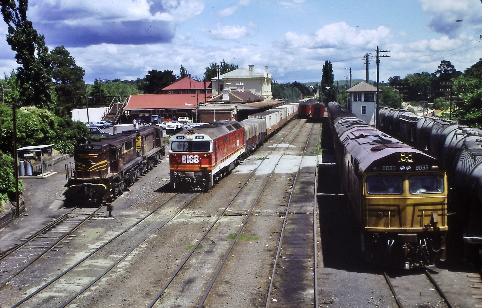 A Sydney-bound freight from southern NSW and Melbourne hauled by 8168 at a crowded Moss Vale, NSW,1985.
