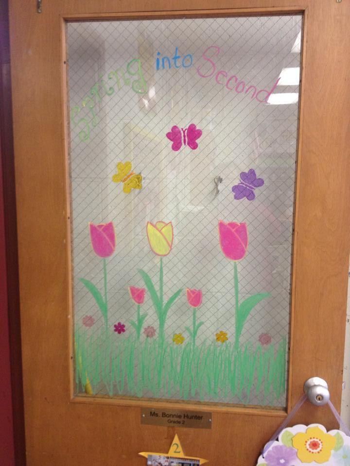 "Using window crayons, ""Spring into Second"" door decor"