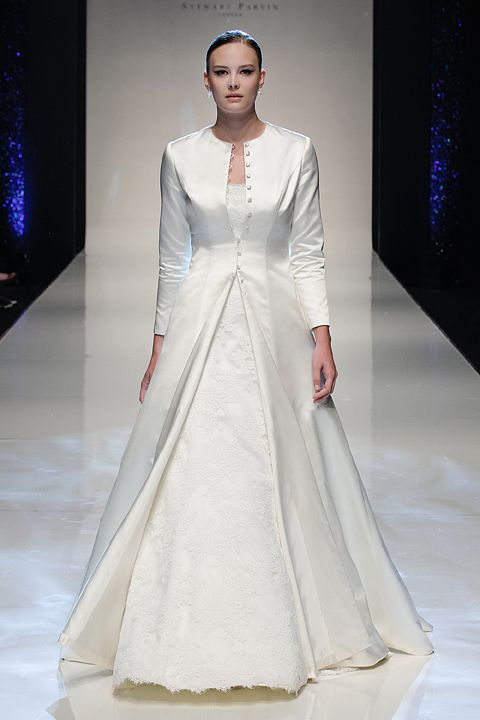 6a46f6ed6f Vision of Love by Stewart Parvin Duchess satin bridal coat with a full  cathedral length train over Where Love Lives corded lace wedding gown. ...