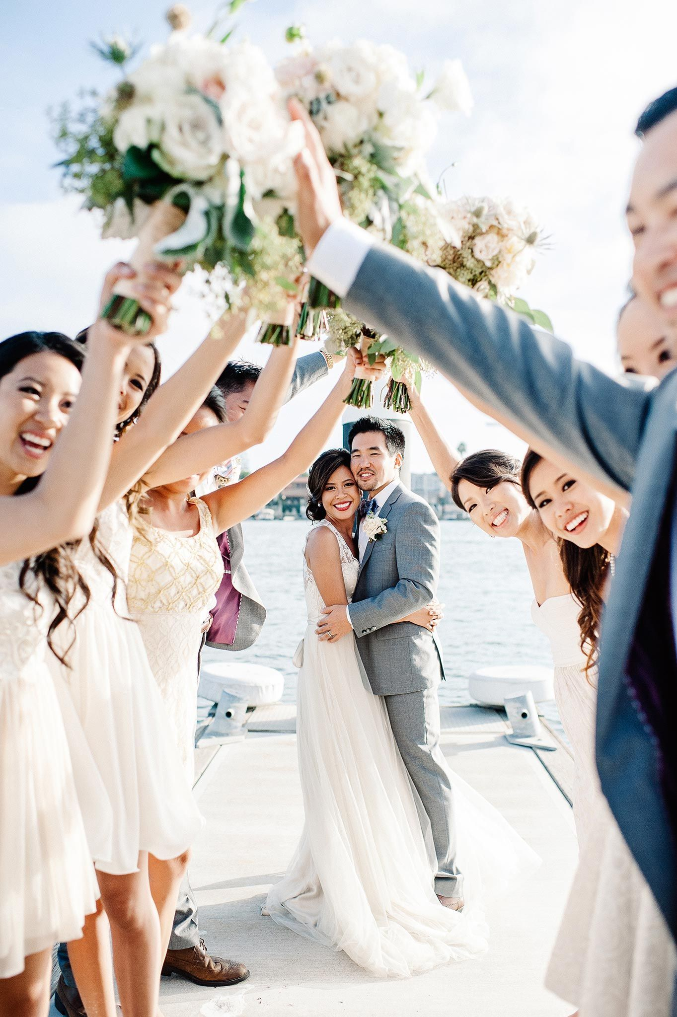 We love how the bridal party frames the couple in this sweet photo ...