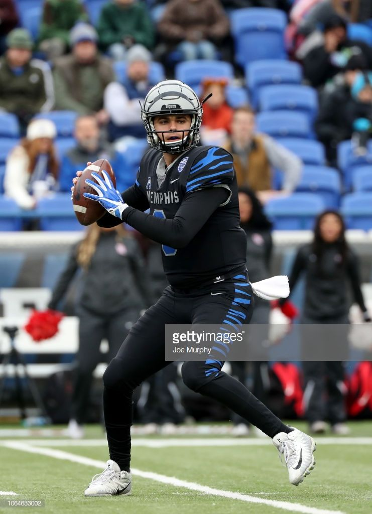 Brady white of the memphis tigers throws the ball against