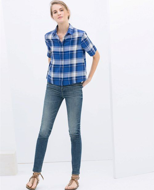 Skinny jeans combined with plaid shirt for a masculine touch ...