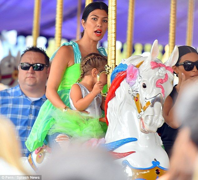 Leaving her problems behind: Kourtney Kardashian took her daughter Penelope to Disneyland on Wednesday just days after news broke that she has split with Scott Disick
