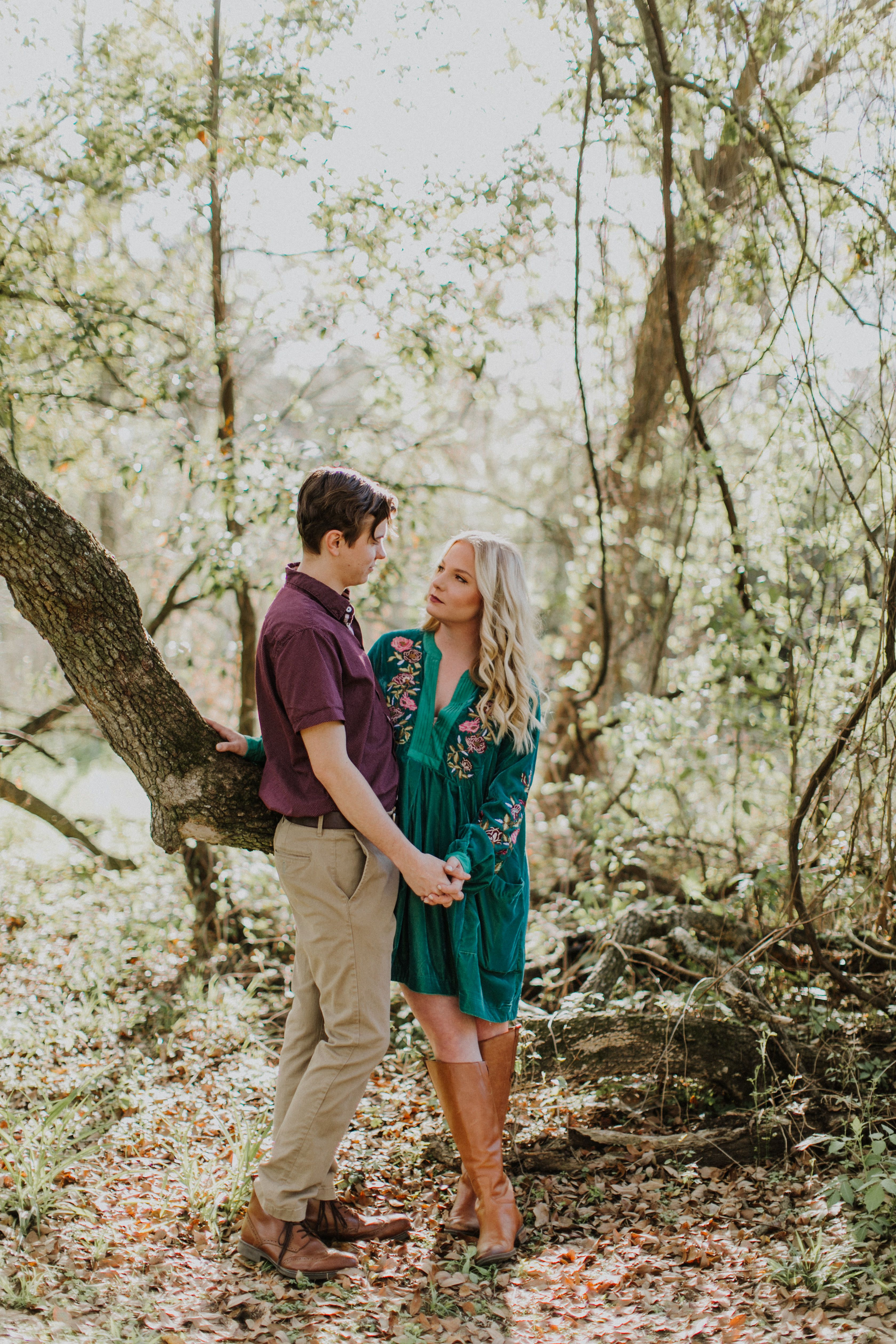 Engagement photos in woods free people dress fall engagement
