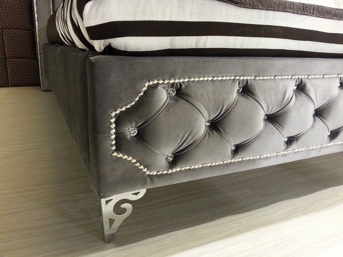 Grey Tufted Bed With Rhinestone Buttons Headboard
