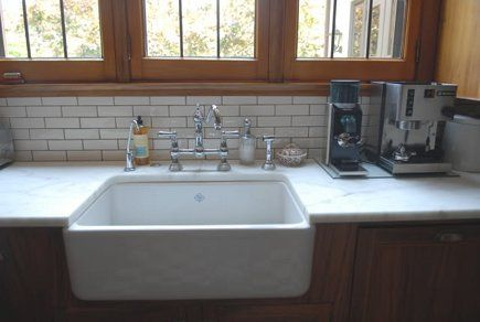 Beneath the casements is a Rohl Shaws single-bowl fireclay apron ...