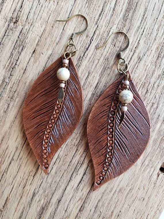 Photo of Items similar to Hand made leather feather earrings on Etsy