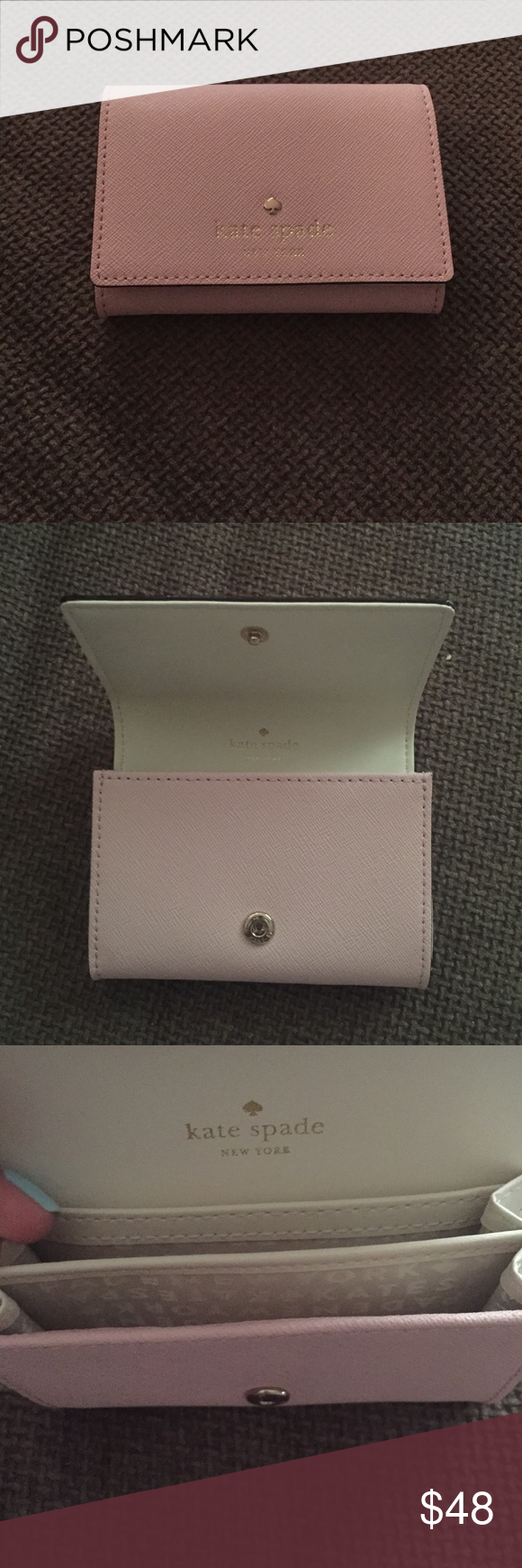 """Kate Spade small pink wallet Small wallet with flap and snap closure. Two slide pockets. Gold foil embossed Kate Spade New York signature with spade stud. Crosshatched leather with smooth leather trim.  Capital Kate jacquard lining. 4.5""""x3.5"""". Never been used Kate Spade Bags Wallets"""