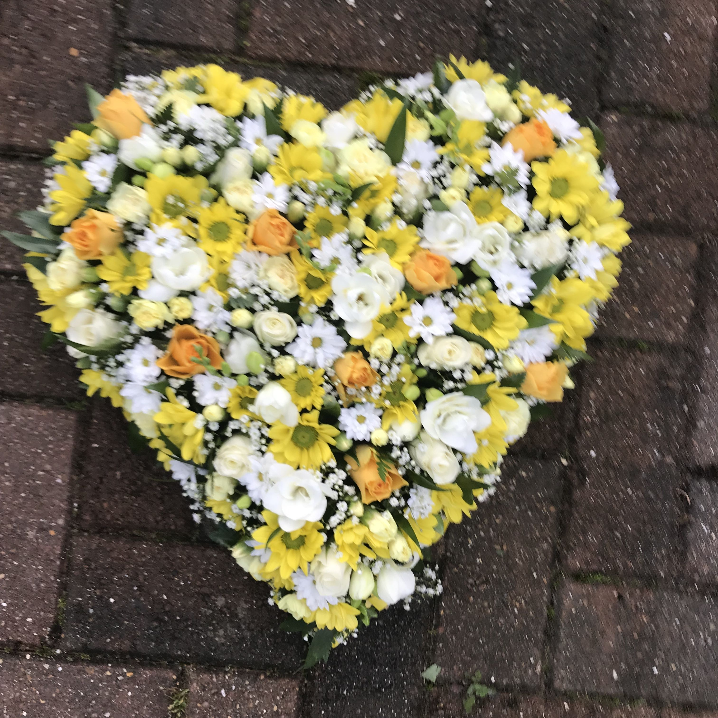 White and yellow loose filled heart funeral tribute of roses experienced freelance florist working from a private studio in gravesend kent specialising in fresh flower arrangements for funerals and weddings offering izmirmasajfo Gallery