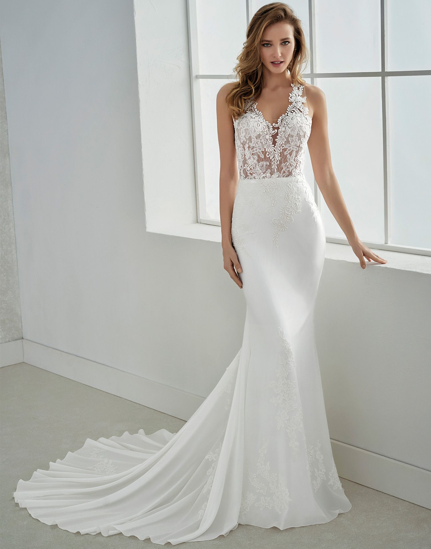 a4ab3f28a4ca FILIPINAS    A gorgeous lace and crepe wedding dress with a bold sheer lace  bodice and soft crepe skirt