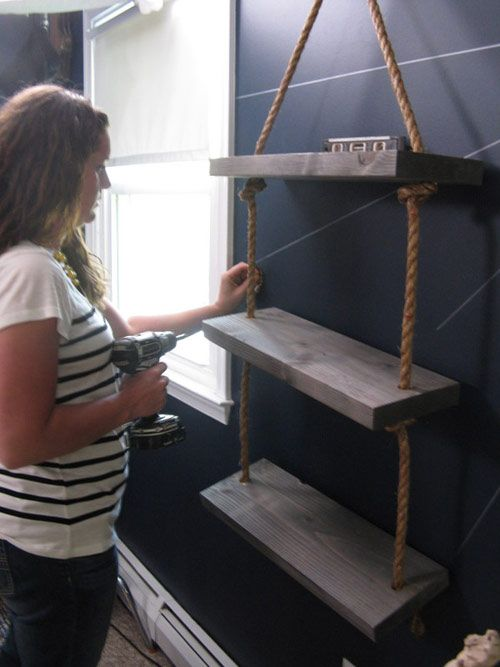Monica securing the shelves in the boy 39 s pirate themed for Boys pirate bedroom ideas