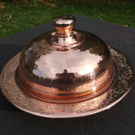 Sometimes when I am out at a flea market or Antique Fair I come across an item I havent seen before - this is one of those things. This cheese dome is hand hammered and hand engraved. It has a tin lining so it is safe for all foods - it is in wonderful condition and it is the first I have ever seen, it should be in my larder......... The base has surface scratches from storage, the tin is hand wiped and all in all it is a lovely thing and will take centre stage on any buffet or dinner table....