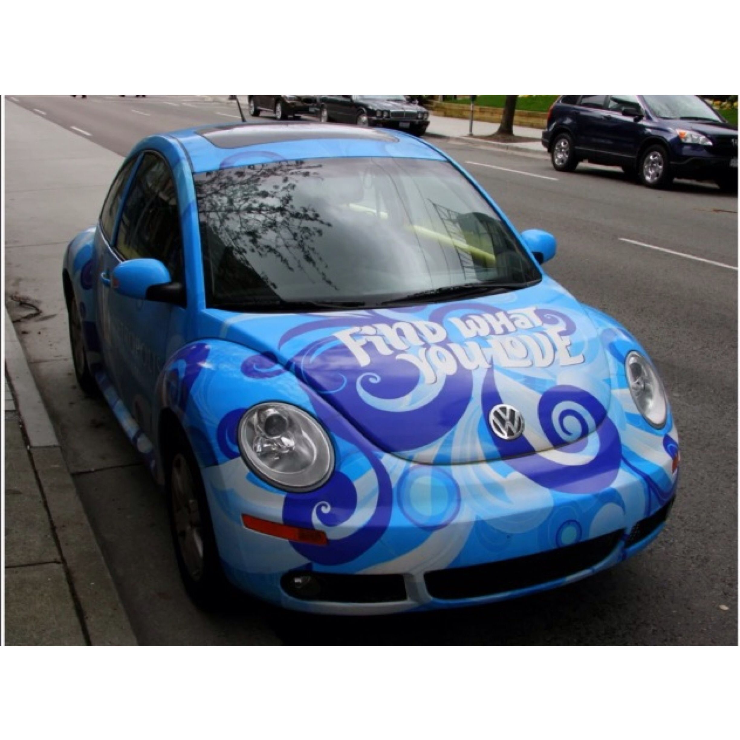 A wrapped vw beetle advertising metrotown mall in vancouver