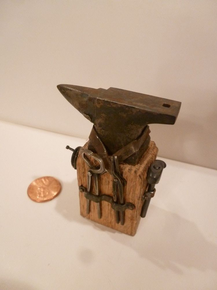 MINIATURE ANVIL MOUNTED ON WOOD WITH TOOLS ATTACHED ON THE SIDES AWESOME PIECE!