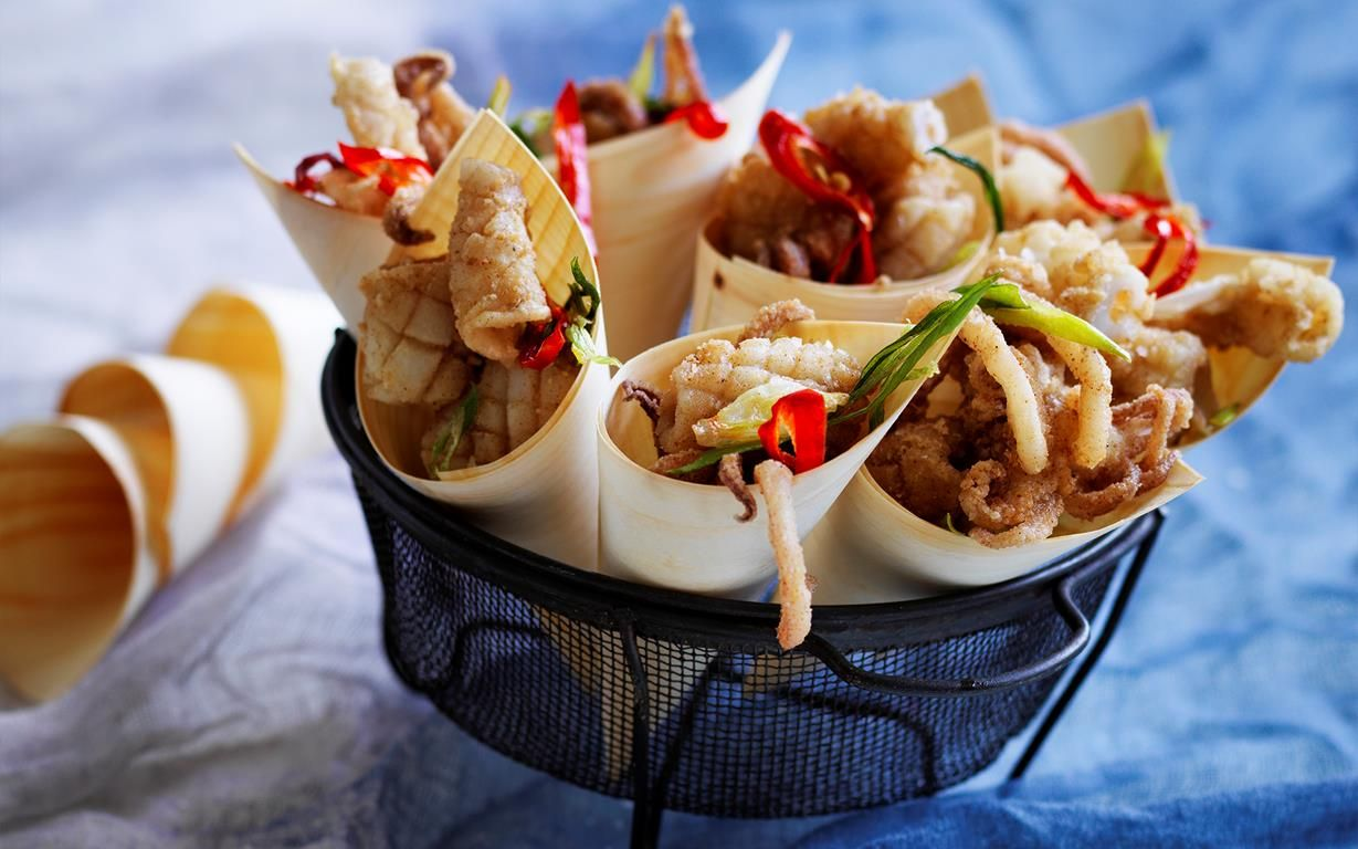 Five spice squid with lime mayonnaise recipe - By Australian Women's Weekly, Excite your dinner guests with this crunchy, succulent and delicious five-spice squid, served with zingy lime mayonnaise. It makes the perfect share-plate for your next dinner party!