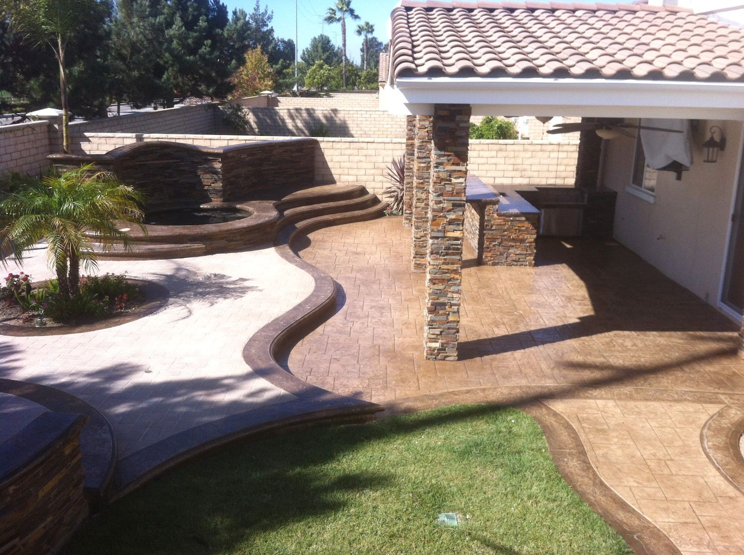 Spa; Waterfall; Outdoor kitchen; Stamped concrete; pavers ...