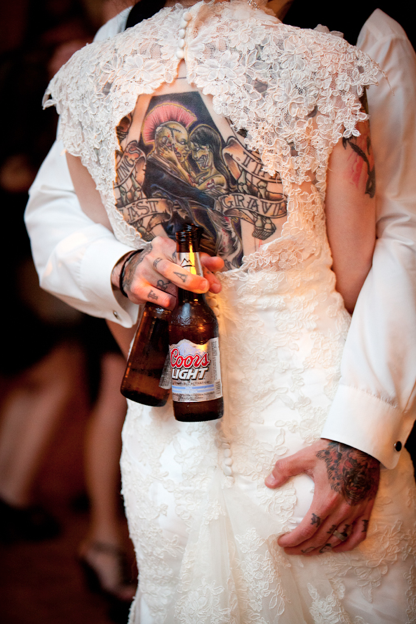 My husband is so classy lol Kristiodom.com is a wonderful photographer :) She captured our wedding beautifully. To see more of our wedding go to rocknrollbride.com and search Edgar Allan Poe and you'll see TJ & Elizabeth. That's us! #tattoo #wedding