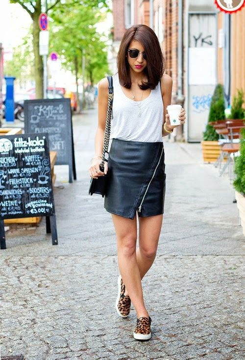 In the warmer weather, pair your sneakers with a leather mini-skirt and simple tank top.