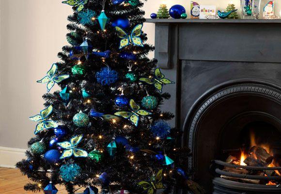 Decoración-de-Navidad-con-mariposasjpg (580×400) arboles de - peacock christmas decorations
