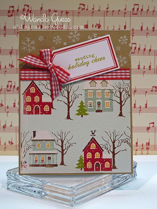 Christmas card using patterend paper with houses in the snow