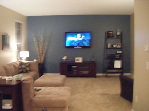 family living room with blue accent wall, heres our tv space. the
