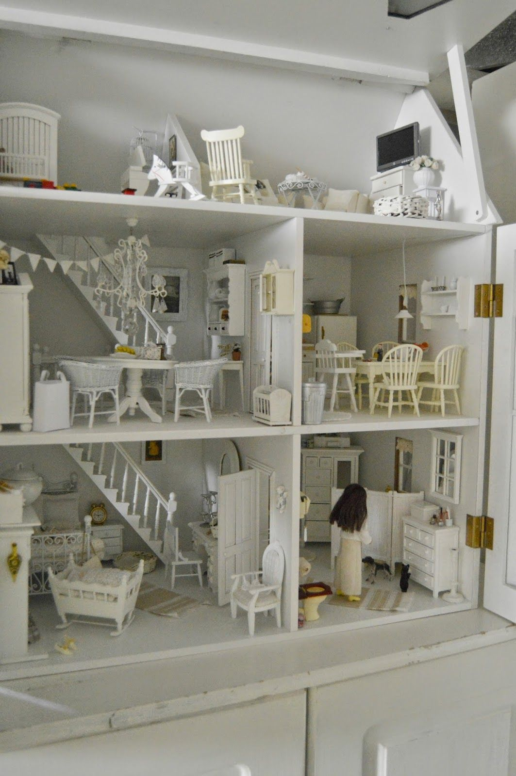 A lovely dolls house - with furniture and the doll!