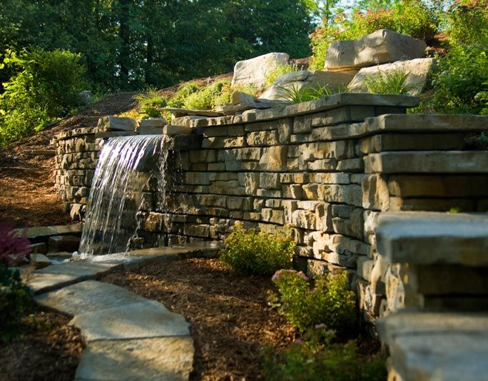Waterfall Coming Out Of A Retaining Wall Cool Idea For The Pond