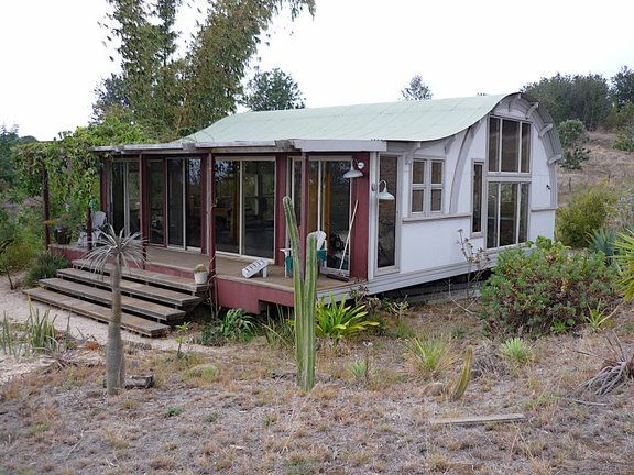Quonset house with porch farm pinterest hut house for Modern quonset homes