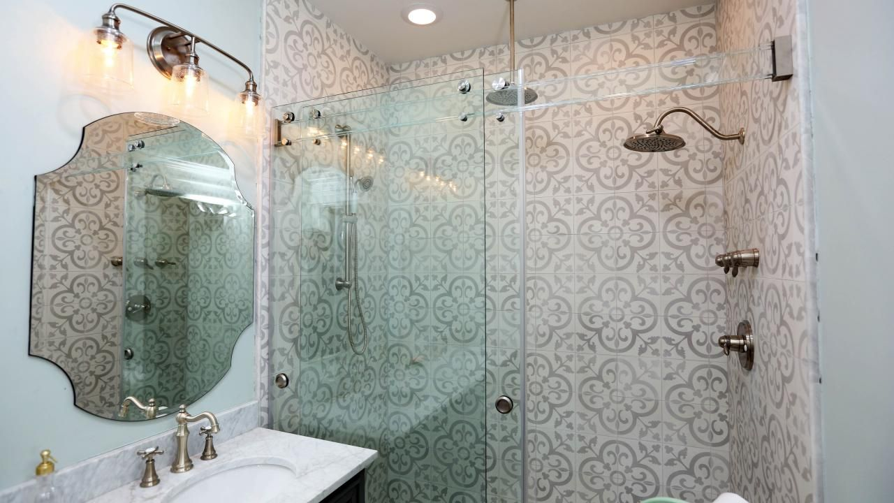 The Large Walk In Shower Features Two Rainfall Showerheads Glass