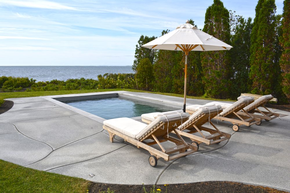 A breathtaking view of the ocean across from the pool at this Rye