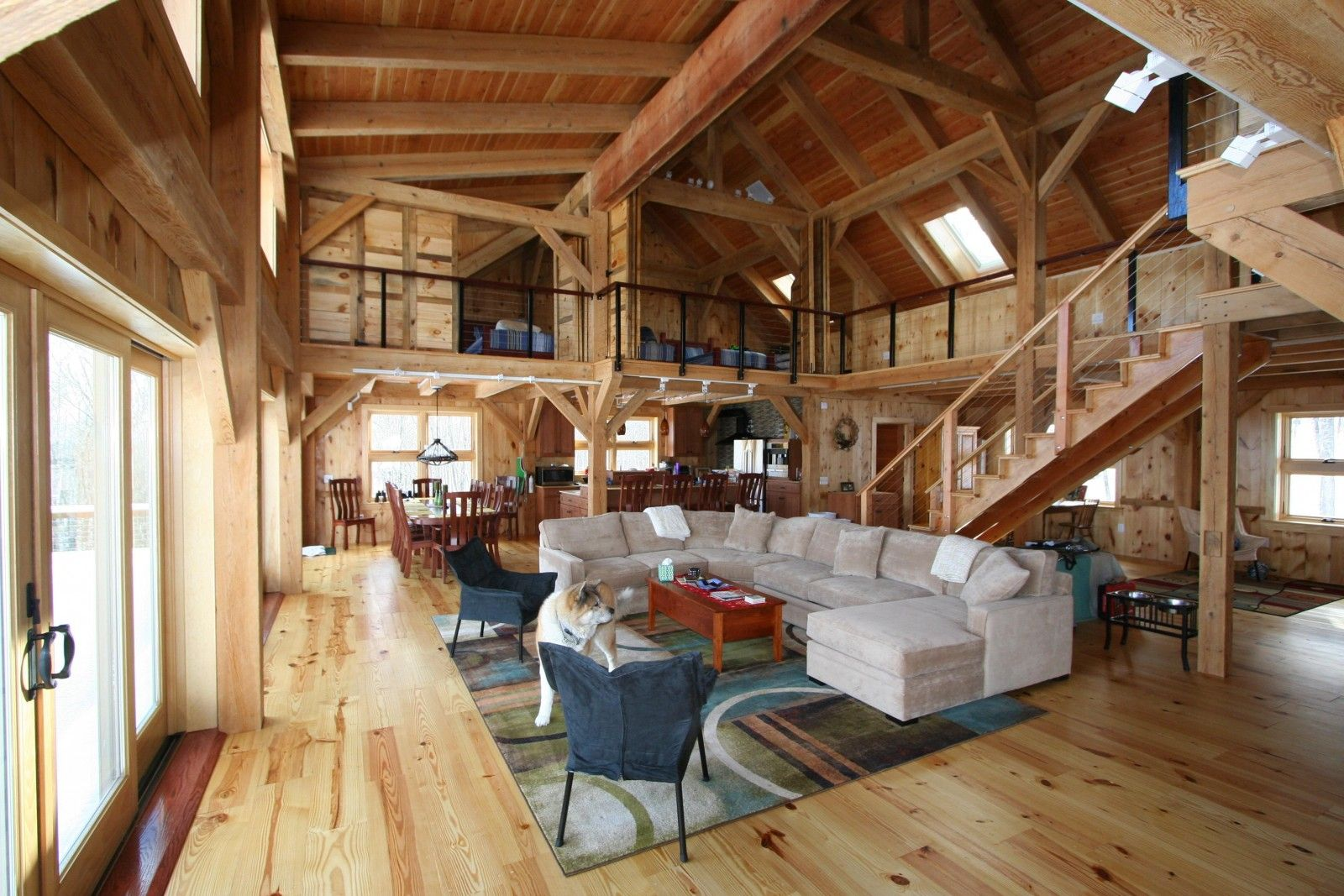 open space and wood timbers mark this lodge interior the beauty